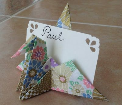 Origami Decorations: Crane Place Card Holder link: http://www.youtube.com/watch?v=PGNrQB8Tzfk&hd=1