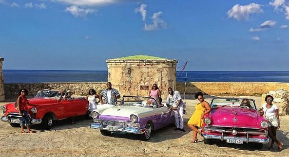 Awesome picture of classic cars and the ocean in Havana, Cuba. Traveling in a group is a great way to see the world and creative lifelong memories.