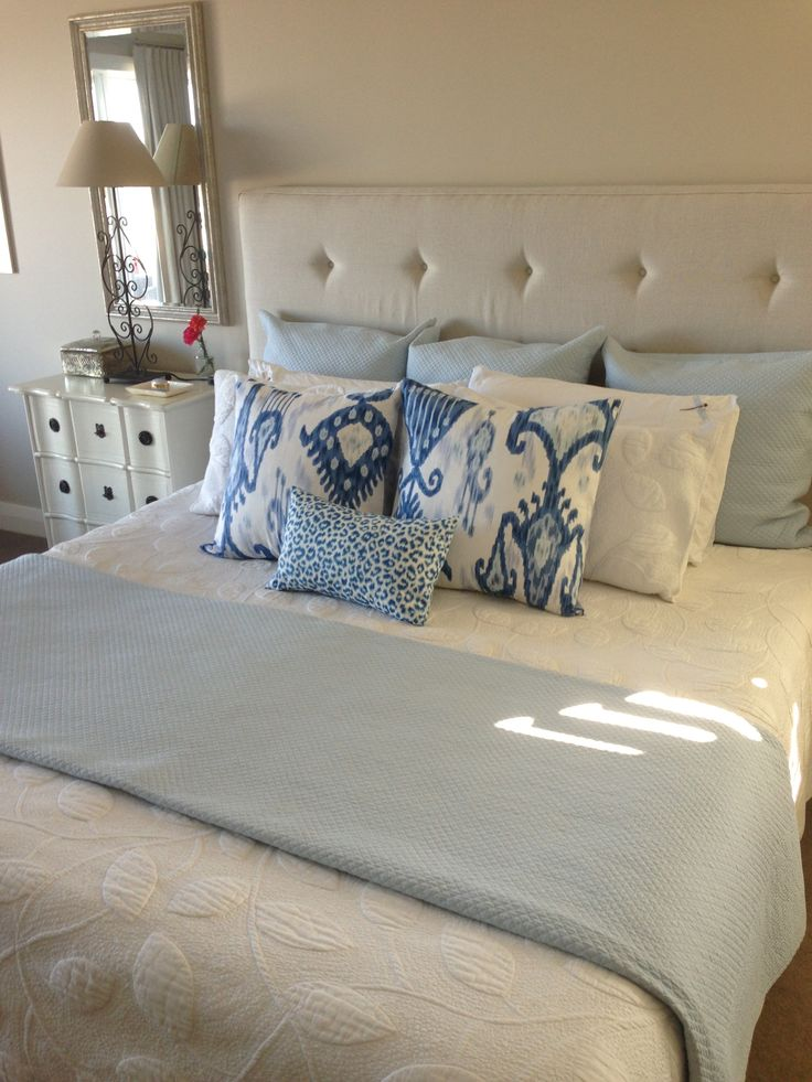 Upholstered bed head in Belgium Linen with Ikat scatter cushions and white quilt!