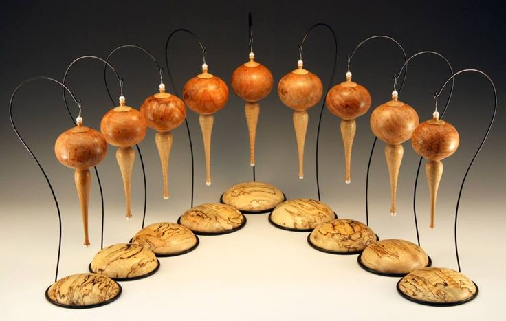Chris Ramsey's ornaments. Drop ceiling wire used for stands.