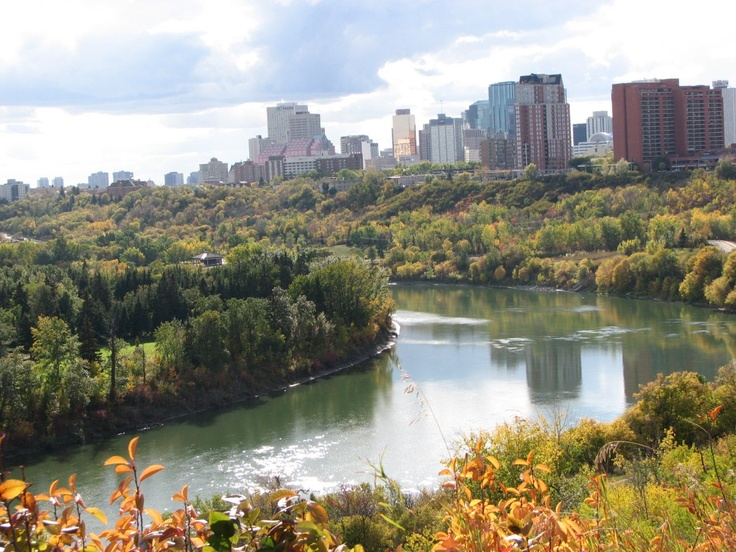 Edmonton, Alberta, Canada.  Largest public park in the country extends throughout the river valley... running, biking, 4 major golf courses, dragon boat racing -- all right downtown.