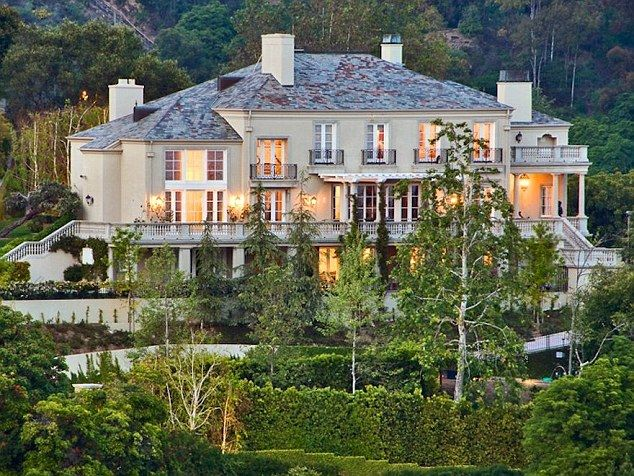 Who get's what? In 2013, Elon Musk bought this20,000-square-foot Bel Air home for a repor...