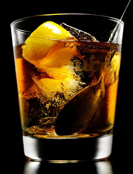 Old Fashion:  Whiskey or Old Fash­ioned glass    1 sugar cube or a tea­spoon of crushed sugar    2 dashes of Angos­tura bitters  Add some water to dis­solve the sugar,   now mix    Add 3 or 4 ice cubes    2 ounces of bour­bon or if desired, rye  Stir and add gar­nish, twist. Some pre­fer orange or cher­ries or both