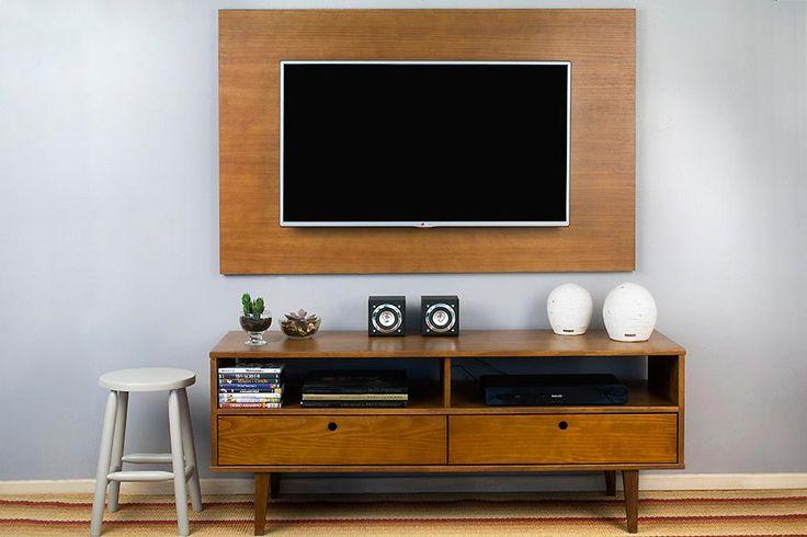 O painel combinado com um rack ou aparador do mesmo acabamento dá elegancia e estilo ao ambiente.