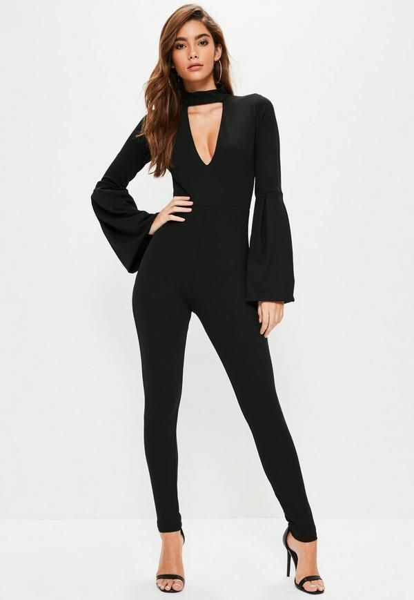 A black jumpsuit is a wardrobe necessity. Make sure you prep for the party season in this one with its choker neck, balloon style sleeves, and a tapered leg style.