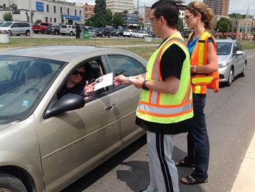 Students help Barrie cops deliver distracted driving message - Georgian College registered practical nursing students Keith Whelan and Brie Hudson hand out their distracted driving information sheet to drivers along Lakeshore Drive. The students partnered with Barrie Police today to highlight the hazards of texting, talking or eating while behind the wheel.