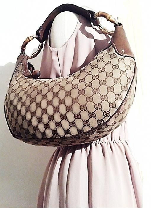 3e0d6bc4cb96 Currently at the #Catawiki auctions: Gucci - Bamboo Monogram Handbag  #Guccihandbags