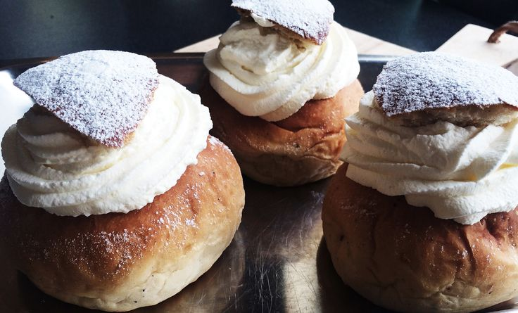 Swedish Semla or Fat Tuesday Buns with almond paste and whipped cream.