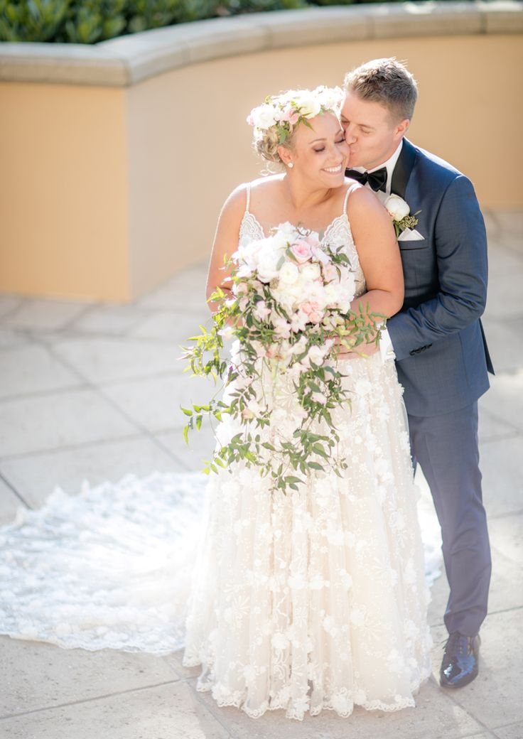 Gorgeous textured beach wedding dress with floral appliques by Berta (Clane Gessel Photography)