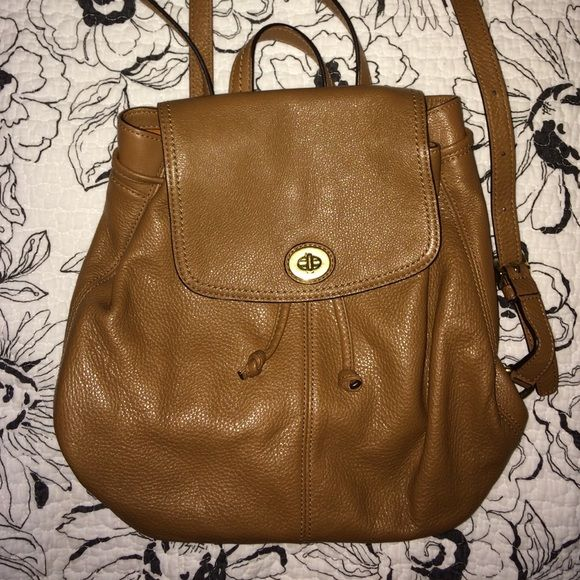 Leather Coach backpack  Chestnut brown leather coach backpack pocketbook. Perfect condition inside and out. Gently used. Authentic coach brand.  make an offer!  Coach Bags Backpacks