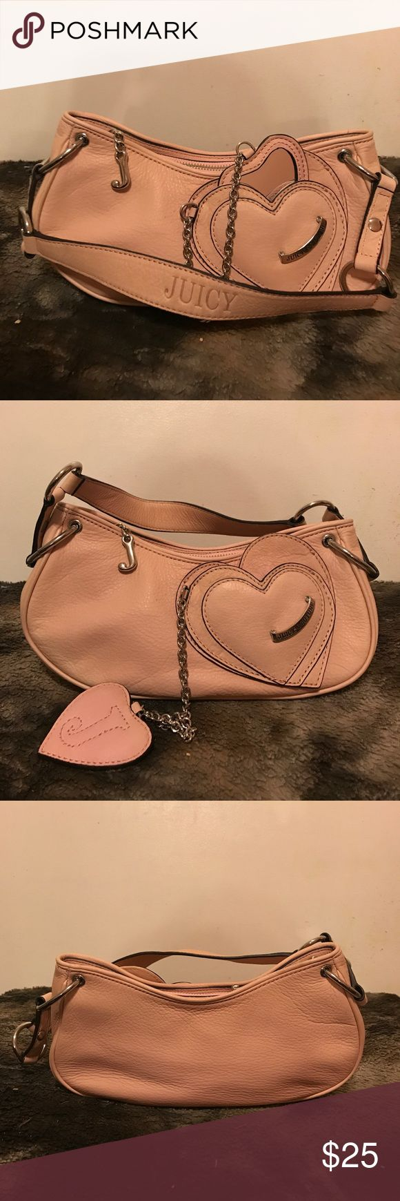 "Authentic Juicy Couture Leather Purse With Mirror! Authentic Juicy Couture Light Pink Leather Mini Shoulder Purse With Mirror! Used but in great shape. Please enlarge photos for details! RN 52002/CA16396. Silver hardware, zipper enclosure, 1 zipper pocket on the inside! 10"" wide, 5"" deep, and 10"" strap! Juicy Couture Bags"