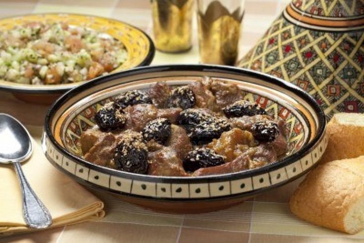 Moroccan dish with meat, plums ans sesameseeds close up