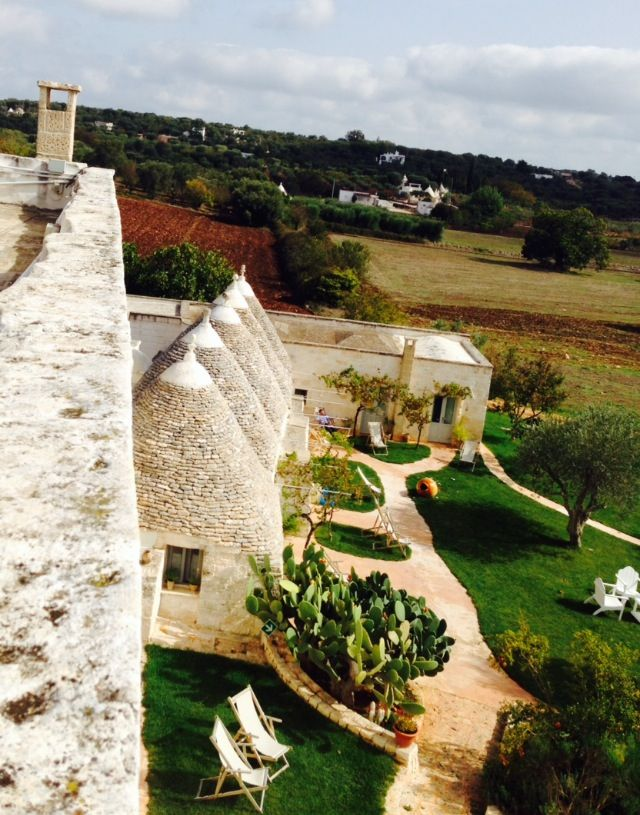 TRULLI AT MASSERIA CERVAROLO. I climbed up to the roof to take this photo. Not easy!