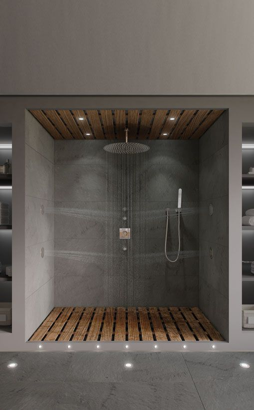 Custom showering area with wooden showering deck and coordinating ceiling finished with VADO brassware. www.vado-uk.com
