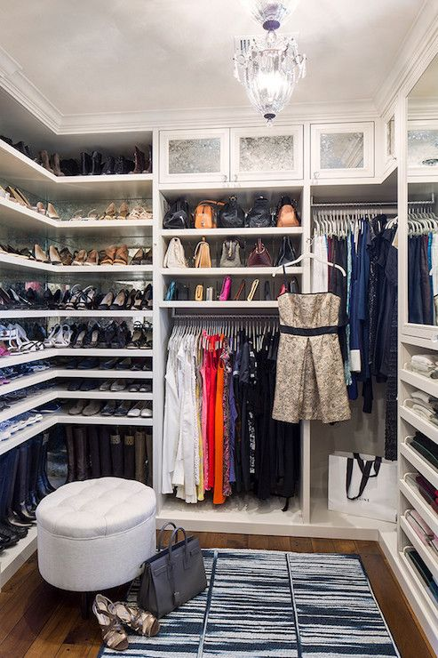 Love this closet setup. Lots of creativity was used for my reach-in to function efficiently. Top shelf: handbags and hats. Choice of lighting and hangers were key in utilizing space efficiently to hang my clothes. I color coded everything making items easy to find. My leather and suede pants are on wooden suit hangers, the rest on padded hangers with frosted vinyl shoulder protectors.