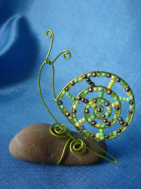 A Wire & bead Snail for the garden. Happily sitting on a stone.