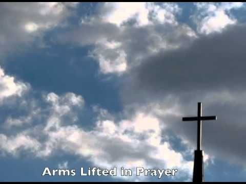 Jesus Face in the Clouds Praying by a Cross