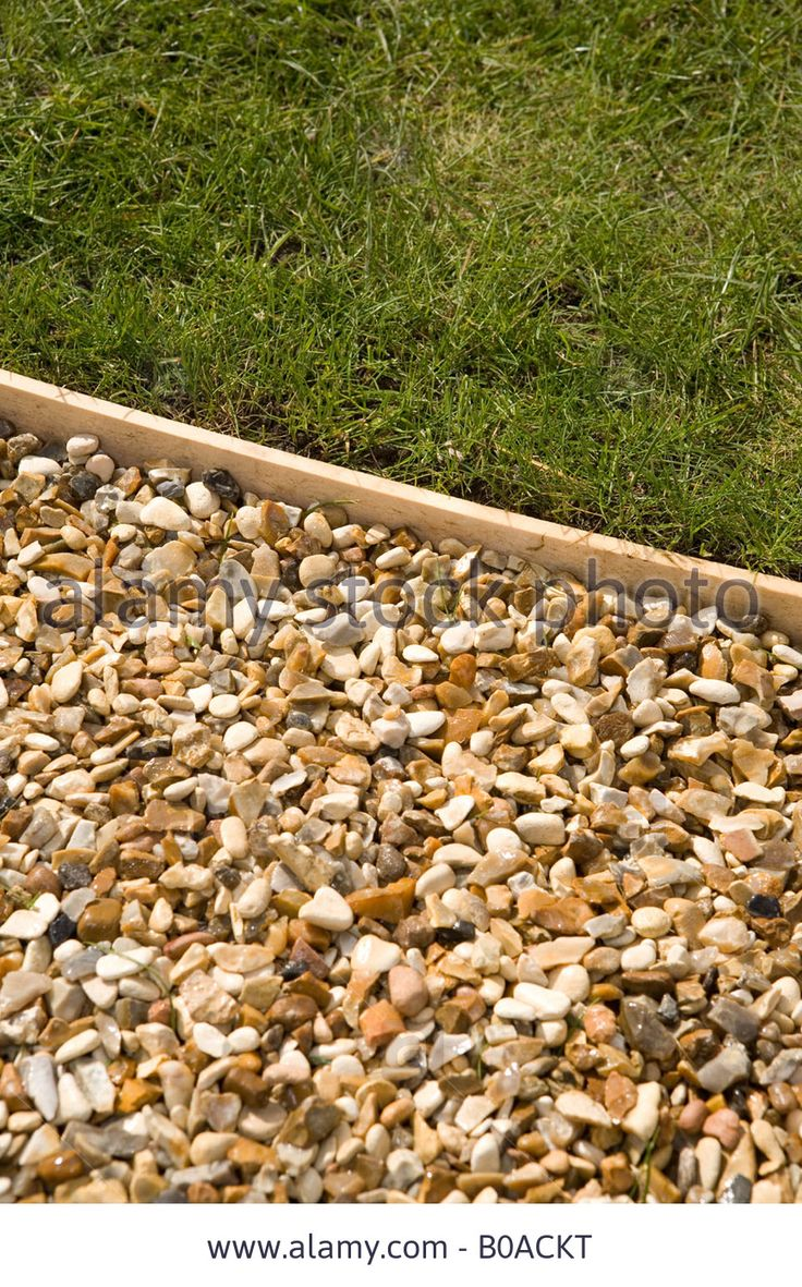 Garden Edging with wood   Gravel Path With Wooden Lawn Edging Stock Photo, Picture And Royalty ...