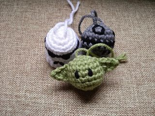 This pattern includes instructions for three different ornaments - Yoda, Death Star, and Stormtrooper. They are done in amigurumi style, and are great for Christmas trees, hanging on a backpack, or sticking on a key chain. Only small amounts of yarn are needed for each, and each can me made in about 20 minutes.