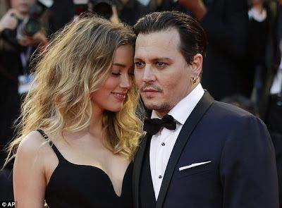 Amber Heard calls police claiming Johnny Depp has breached restraining order