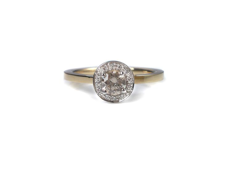 light brown Diamond with tiny diamonds round and round.... set in 14 kt white and rose gold.