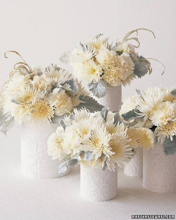Vases wrapped in embossed wallpaper to mimic pressed plaster or tin. So pretty!