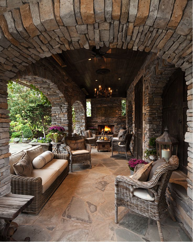 This intimate cabana with reclaimed wood and drystacked stone has a rustic elegance and charm.  Of course there's a TV behind old French architectural doors. http://www.rameshwaramarts.co.in/catalogues.php