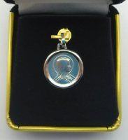 Our Lady of Lourdes White Gold Medal.