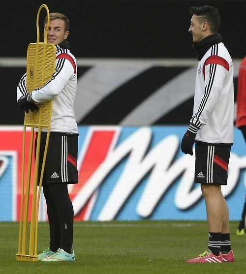 "Ozil and Gotze, ""So if this was your girlfriend, you should hug her like this, trust me it works..."" LOL"