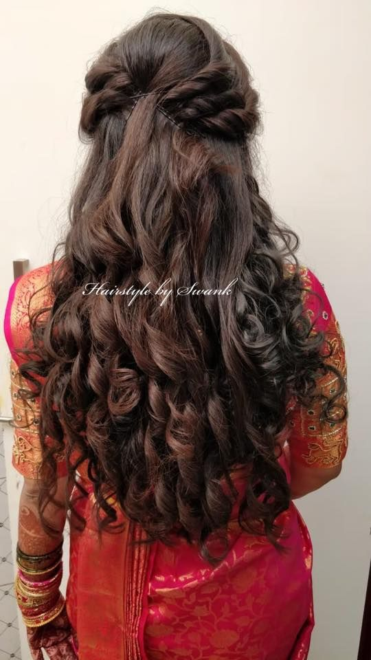 Pretty cascading curls! Gorgeous bridal hairstyle by Team Swank. Indian bridal reception hairstyle. Bridal silk saree. Saree blouse design. South Indi...