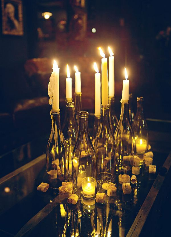 Wine bottle and candle decor #wedding #reception #classic the corks are wrapped with quotes about love