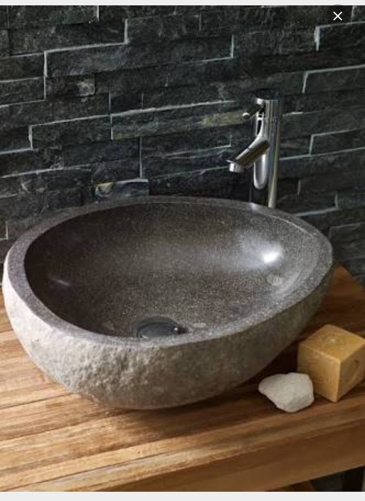 Stone basin on wooden benchtop