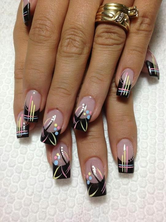 A set a black nails that are actually cute