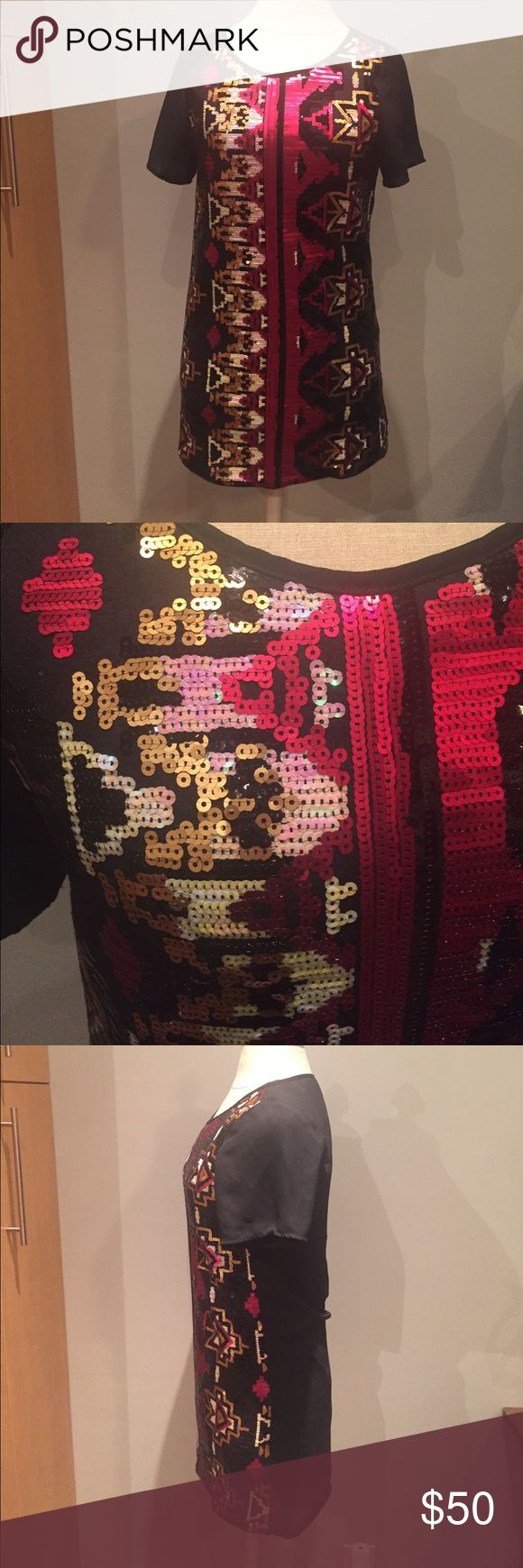 Gorgeous sequin tunic Absolutely stunning sequin tunic. Complete sequin front with beautiful pattern. Solid black back. Long tunic. Could be worn as dress if you are on the shorter side. Worn once. Like new condition. Everly Tops Tunics