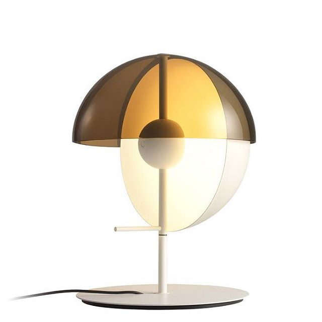 #German born #designer #MathiasHahn initially studied industrial design at Essen university, then went on to further studies at the Royal college of the arts in London under Ron Arad.  The influence and design aesthetics of both his British and German training can be seen in his works, where form and function blend with historical perspectives.  The #Theia #lamp created in #2016 was named after the Greek goddess who was the mother of the sun, moon and the dawn. The #tablelamp has been…