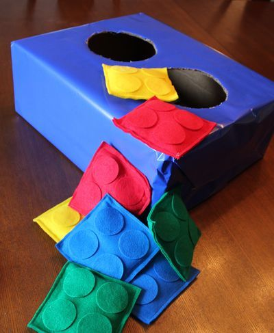 """Lego party: """"filled a little Ziploc baggie with rice, shoved it between the two squares, stitched up around the edges and TADA....Lego Beanbags/toss"""""""