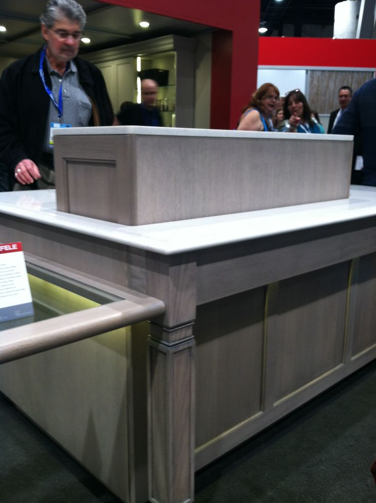 Pop up/hidden bar from the Hafele America booth.  Cabinetry by Plain & Fancy Custom Cabinetry #KBIS2014