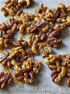 Photo: Quentin Bacon 		  		 			 		  		1 cup each whole roasted salted cashews, whole large pecan halves, whole unsalted almonds, and whole walnut halves (4 cups total) 1½ cups sugar 2 teaspoons pure vanilla extract 2 teaspoons kosher salt 1 teaspoon fleur de sel    		Preheat the oven to 350 degrees.   Combine the nuts on a sheet pan, spread them out, and roast them for 7 minutes, until they become fragrant. Set aside to cool.  After the nuts are cooled, place the sugar and ¼ cup of water in…