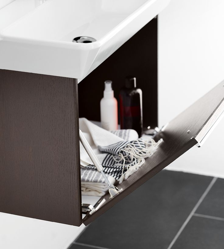 The Small washbasin floats elegantly above the unit, offering maximum room in the cabinet below