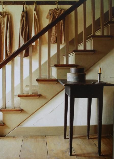 painted stairs with wood treads; board on wall for decorating