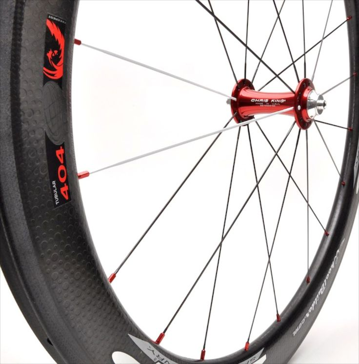 Precision handcrafted Zipp 404 Firecrest carbon tubular rim with red Chris King R45 front hub, black/white DT Swiss aerolite bladed spokes, and red Wheelbuilder.com high-strength alloy nipples. 531g.