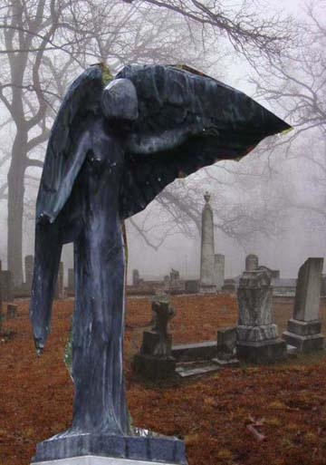 From an abandoned cemetery in Georgia??looks like black angel at Oakland cemetery in iowa city, ia