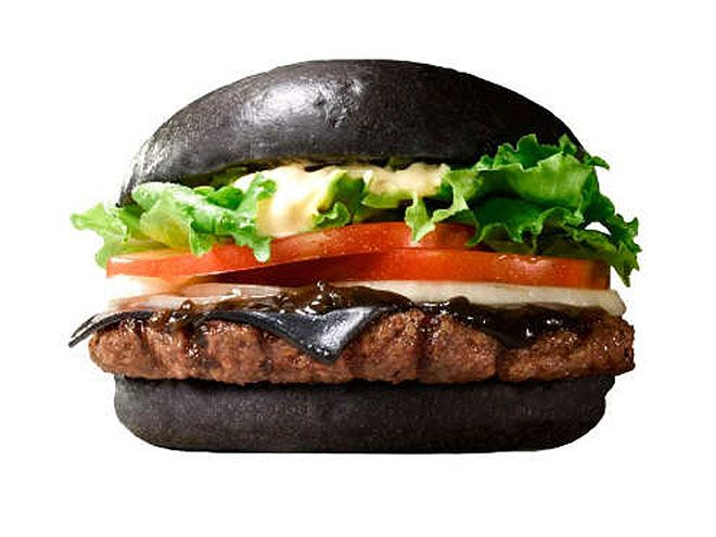 The 10 Weirdest International Fast Foods of 2014 | BLACK BURGER | It was a whopper of innovation: Burger King Japan's Kuro (black) burger included black cheese made from bamboo charcoal and black sauce courtesy of black squid ink on a charred black bun.