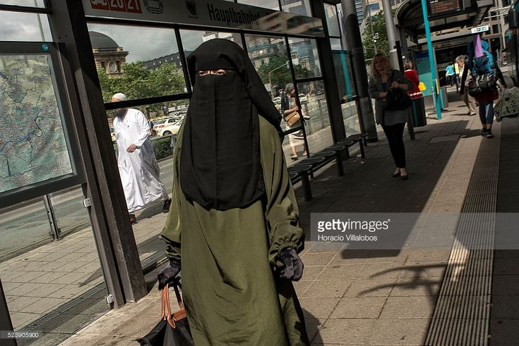 A woman wears niqab at Hauptbahnhof tram stop in Frankfurt, Germany, 21 June 2013. Although Germany has so far steered out of the issue, Hesse, a state run by CDU ruling party, has banned since 2011 Muslim face veils for its workers, because 'public sector workers must have neutral religious and political views'. A court in Bavaria has banned, on 22 April 2014, a 18-year-old Muslim student from wearing a face veil in class, rejecting her argument that she had a constitutional right to do so.