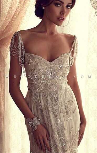 What a great dress for a second wedding or renewal of vows, a dress that requires a little age to carry off. However the fit in the bust on this model is off.