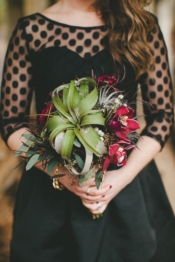 air plant bouquet, photo by Shari + Mike Photographers http://ruffledblog.com/pacific-northwest-rainforest-wedding #weddingbouquet #bridesmaid #airplants