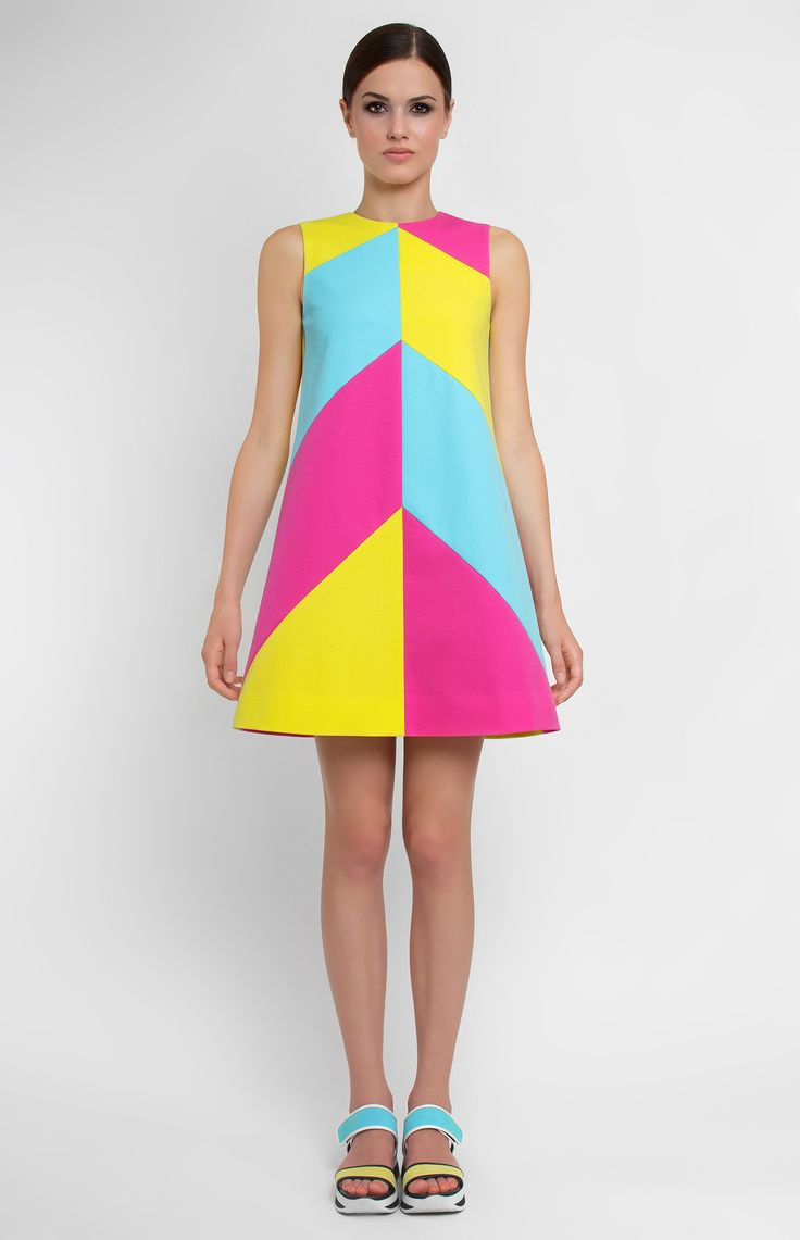 Sleeveless A-shape multi-color stretchy cotton dress. Round neck. Hidden back zip closure. Without pockets and unlined.