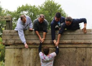 Men tackling The Wall at Mill on the Brue outdoor activity centre