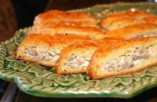 Sausage Crescent Rolls- 2 cans crescent rolls, 1lb sausage, 1 block softened cream cheese, 1 egg white, poppy seeds.  Brown and drain sausage, mix with cream cheese, spread over strip of crescent rolls.  Top with another strip and seal edges.  Brush with egg white, sprinkle poppy seeds.  350 for 25 min.  Cool and slice!