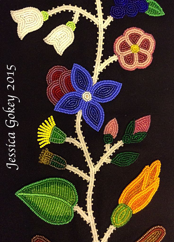 Close up on panel for MNHS Project: Designed and beaded by Jessica Gokey Squash blossom, dandelions, rose buds, wild rose and blueberry blossoms.